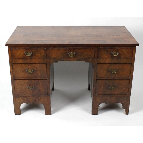886 - A 19th century mahogany-veneered twin pedestal desk. The figured rectangular top over central frieze...