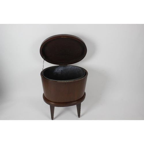 887 - An early 19th century mahogany cellaret. Of tapering oval form with hinged cover enclosing a metal l...