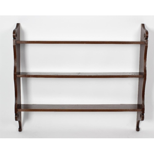 889 - A set of Regency mahogany open wall shelves, the three shelves each with triple-reeded front, betwee...