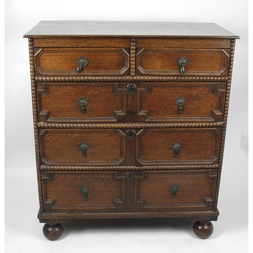 895 - A 17th century-style oak geometric chest of drawers, early 20th century, The two-plank rectangular t...