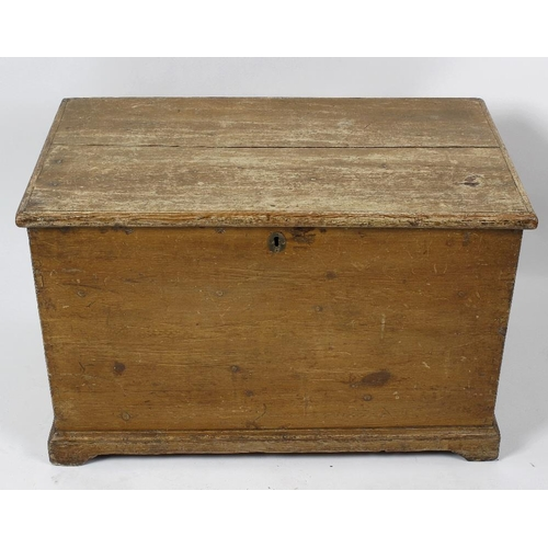 898 - A George III stained pine bedding box or trunk. The hinged two-plank top enclosing a candle-box, the...
