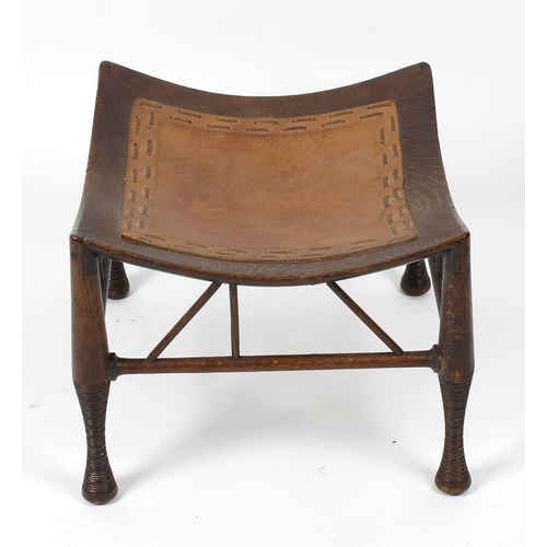 903 - A late 19th century oak Thebes stool, probably designed by Leonard Wyburd and made by B. North or Wi...