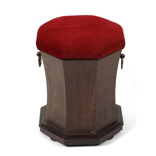 906 - A Victorian pine box seat or ottoman, the wine plush-covered  octagonal top on waisted body with bra...