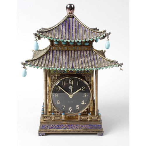 91 - A mid 20th century Chinese silver-gilt, turquoise and enamel clock, of two-tier pagoda form with blu...