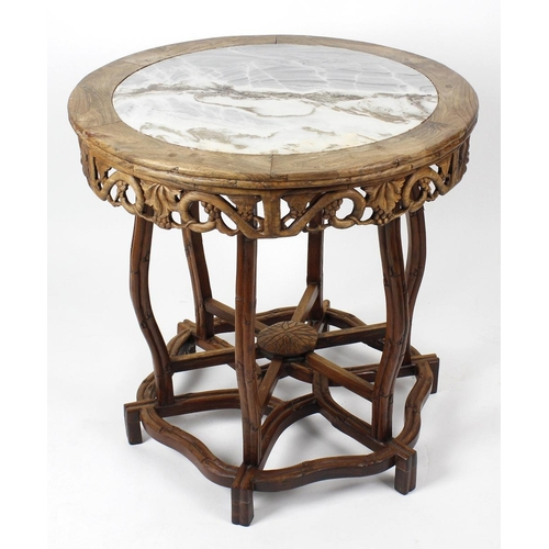 911 - A Chinese marble-topped carved blackwood centre table, the circular top with inset grey-white marble...
