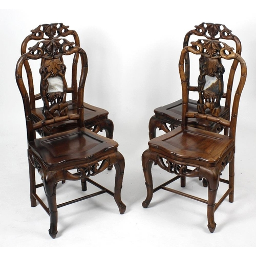 912 - A set of four Chinese marble-inset blackwood dining chairs, matching the preceding lot, each of 'bal...