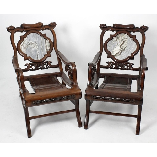 913 - A pair of Chinese marble-inset blackwood easy arm chairs. Each toprail carved with gourds and leaves...