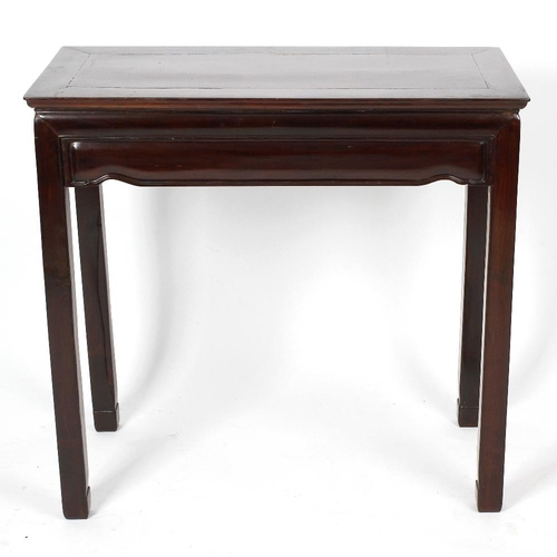914 - A Chinese hardwood side table or altar table. The cleated rectangular top over cushion-moulded friez...