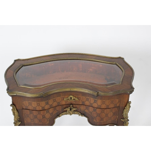 916 - A French brass-mounted rosewood and marquetry bijouterie table, the brass-bound top of serpentine-si...