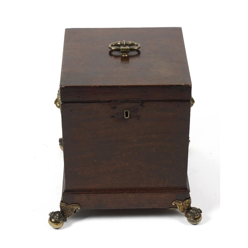 918 - A George III mahogany cellaret, the hinged square cover, with central brass loop handle, enclosing a...