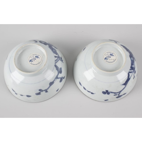 92 - Two Chinese Nanking Cargo porcelain 'Peony Rock' pattern rice bowls, each of hemispherical form on f...