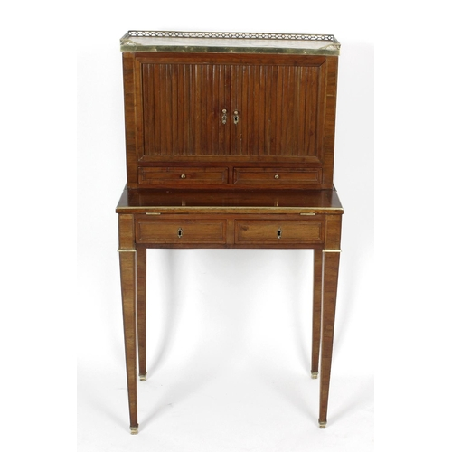 923 - A French marble-topped walnut bonheur-du-jour. The superstructure with pierced brass three-quarter g...