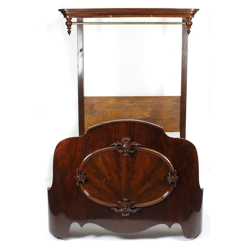 926 - A late Victorian mahogany half tester bed, the raised back with hanging corner canopy, supporting br...