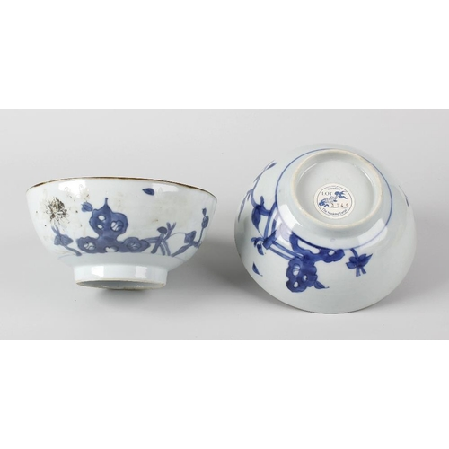 93 - Two Chinese Nanking Cargo porcelain 'Peony Rock' pattern rice bowls, each of hemispherical form on f...