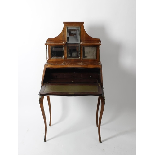 930 - An inlaid rosewood bureau de dame, circa 1900. The shaped superstructure with central long mirror be...