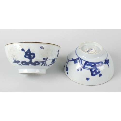 94 - Two Chinese Nanking Cargo porcelain 'Peony Rock' pattern rice bowls, each of hemispherical form on f...