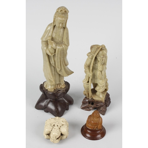 96 - A group of Oriental cabinet items, comprising: two soapstone figures, the larger carved as Kwanyin/G...