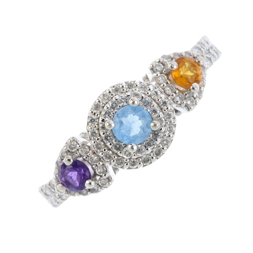 1 - An 18ct gold diamond and gem-set dress ring. The circular-shape citrine, blue topaz and amethyst lin...