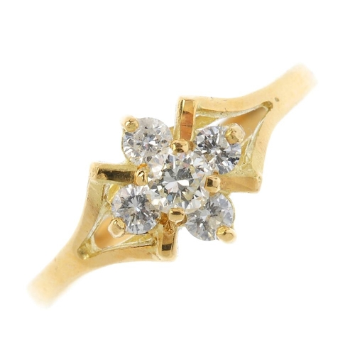 100 - An 18ct gold diamond cluster ring. The brilliant-cut diamond cluster, with openwork shoulders and pl...