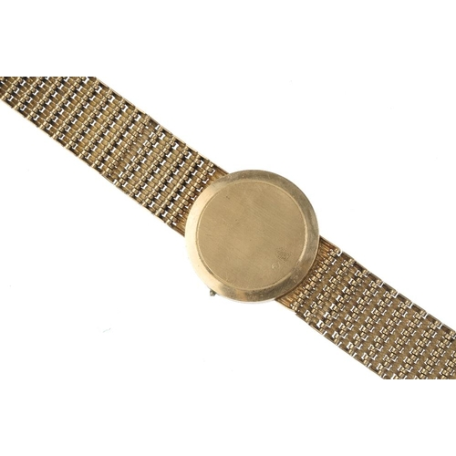 1000 - A gentleman's 9ct gold watch. The circular-shape dial, with baton hour marker's, with an integral br...