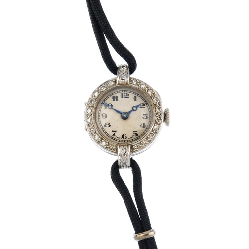 1001 - A lady's early 20th century manual-wind diamond cocktail watch. The circular-shape white dial with b...