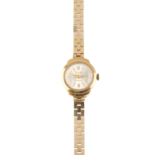 1002 - Four watches. To include an Accurist watch head, a 9ct gold circular-shape silvered dial with expand...