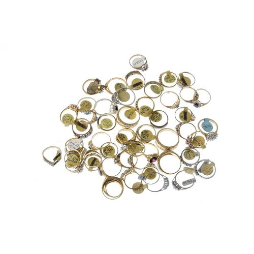 1004 - A bag containing fifty gem-set dress rings. In a variety of designs, to include a synthetic opal and...