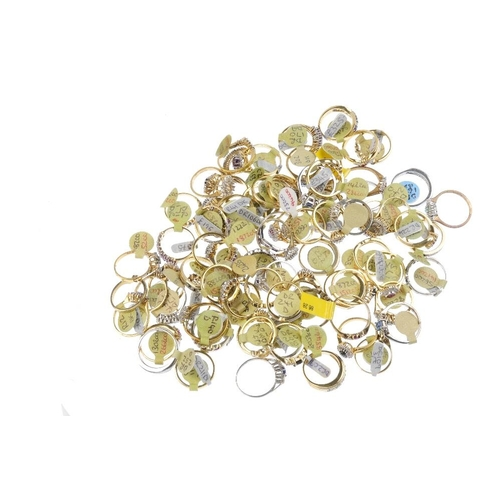 1005 - A bag containing eighty gem-set dress rings. In a variety of designs, to include a sapphire and cubi...