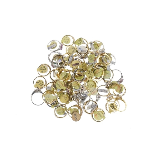 1007 - A bag containing sixty gem-set dress rings. In a variety of designs, to include a ruby and cubic zir...