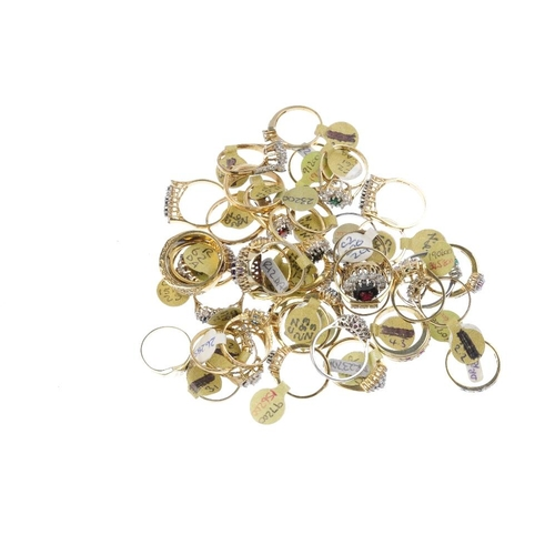 1008 - A bag containing forty gem-set dress rings. In a variety of designs, to include a sapphire and cubic...