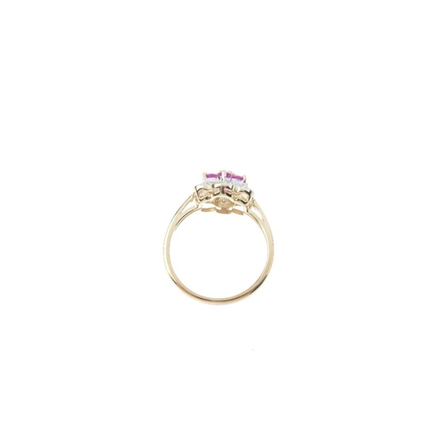 101 - A 9ct gold ruby and diamond floral cluster ring. The circular-shape rubies, within a single-cut diam...