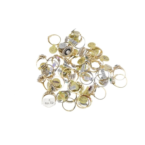 1010 - A bag containing forty gem-set dress rings. In a variety of designs, to include a sapphire and cubic...