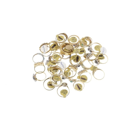 1011 - A bag containing forty gem-set dress rings. In a variety of designs, to include a garnet and cubic z...