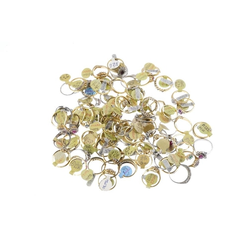 1014 - A bag containing eighty gem-set dress rings. In a variety of designs, to include a sapphire and cubi...