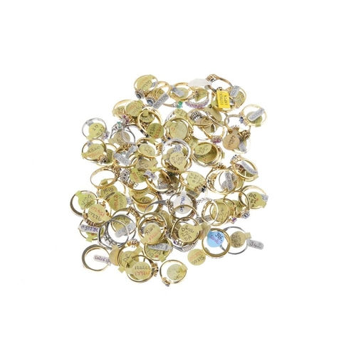 1015 - A bag containing eighty gem-set dress rings. In a variety of designs, to include a sapphire and diam...