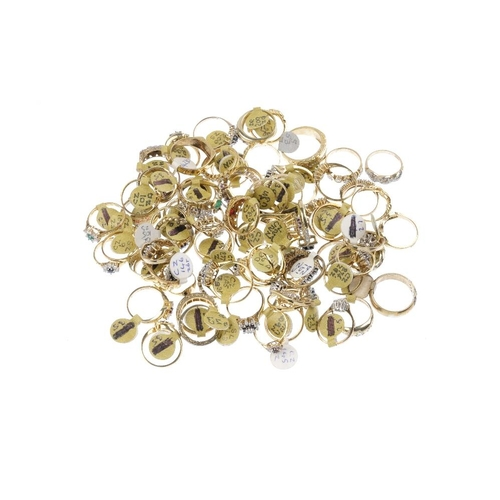 1016 - A bag containing eighty-five gem-set dress rings. In a variety of designs, to include a cubic zircon...