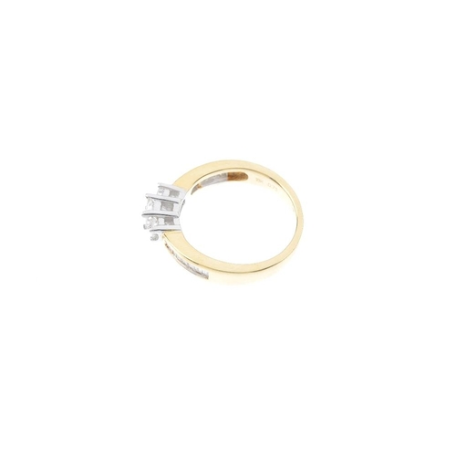 102 - An 18ct gold diamond three-stone ring. The graduated square-shape diamonds, with baguette-cut diamon...