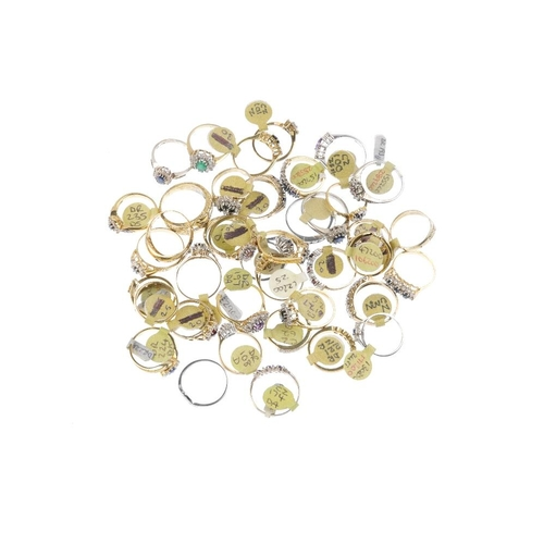 1024 - A bag containing forty gem-set dress rings. A variety of designs, to include a ruby and cubic zircon...