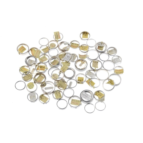1029 - A bag containing sixty-six band rings. A variety of designs, to include a cubic zirconia ten-stone b...