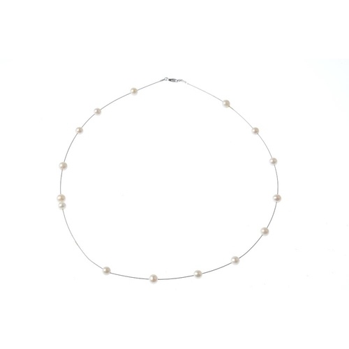 103 - A 14ct gold cultured pearl necklace. Designed as a series of fifteen cultured pearls, measuring appr...