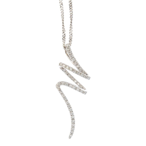 104 - A 9ct gold diamond pendant. Designed as a brilliant-cut diamond scrolling line, suspended from a fla...