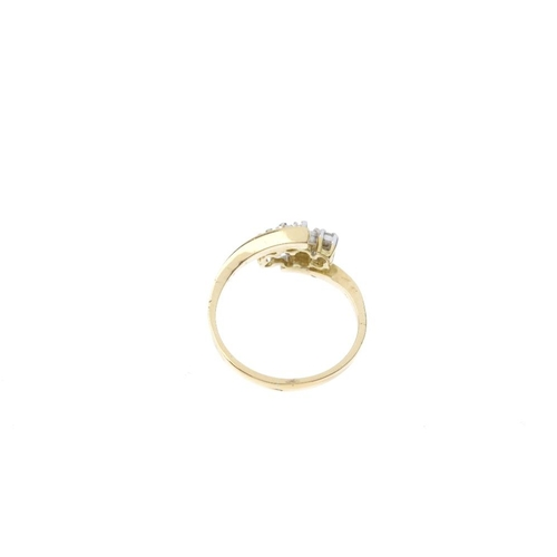 106 - An 18ct gold diamond cluster ring. The brilliant-cut diamond floral cluster, with asymmetric shoulde...