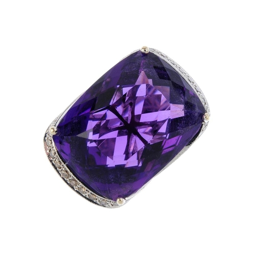 108 - An amethyst and diamond cocktail ring. The rectangular-shape amethyst, with brilliant-cut diamond cr...