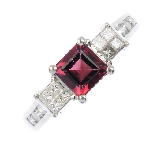 11 - An 18ct gold tourmaline and diamond dress ring. The square-shape pink tourmaline, with square-shape ...