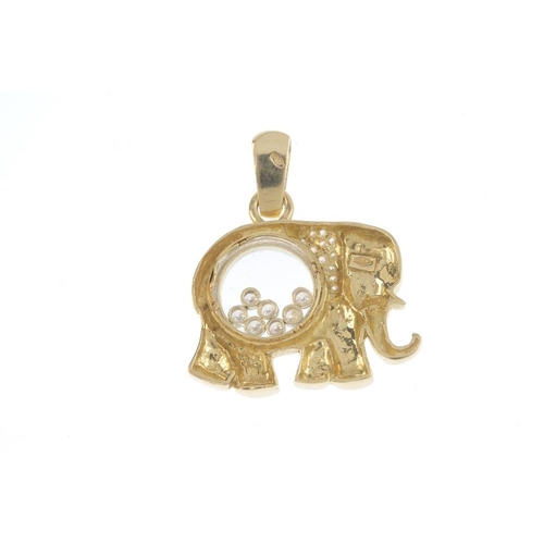 110 - A cubic zirconia novelty pendant. Designed as an elephant, the body with seven free moving circular ...