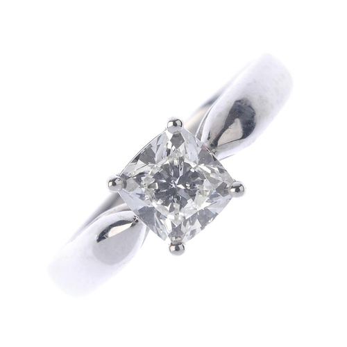 1102 - (131289-1-A) A diamond single-stone ring. The cushion-cut diamond, weighing 1.02cts,  to the raised ...