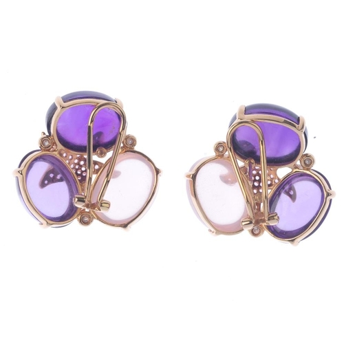 1105 - (131366-1-A) A pair of gem-set ear studs. Each designed as a rose quartz and two varying-hue amethys...