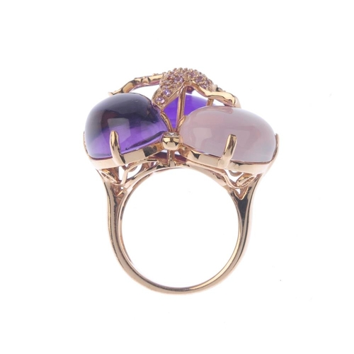 1106 - (131366-2-A) A gem-set dress ring. Designed as a rose quartz and two varying-hue amethyst cabochons ...