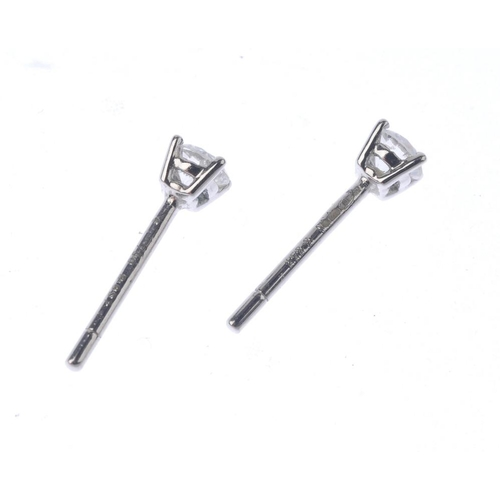 1111 - (131529-2-A) A pair of 18ct gold diamond single-stone ear studs. Estimated total diamond weight 0.30...