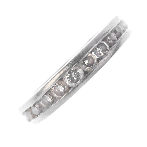 1112 - (131544-1-A) A platinum diamond half-circle eternity ring. The slightly graduated brilliant-cut diam...